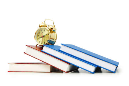 back in time: Back to school concept with books and clock Stock Photo