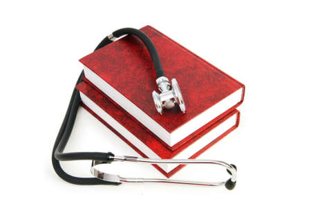Concept of medical education with book and stethoscope Stock Photo - 7322648