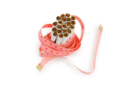 Smoking concept with measuring tape and cigarettes photo