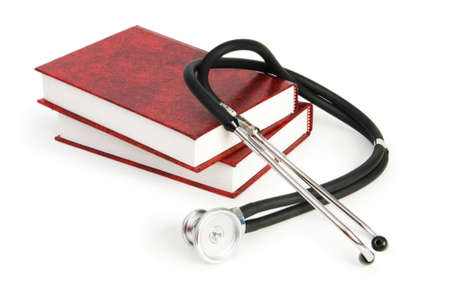Concept of medical education with book and stethoscope Stock Photo - 7396525