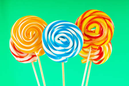 candy stick: Colourful lollipop against the colourful background Stock Photo