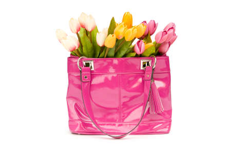 Bag and flowers isolated on the white background photo