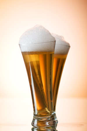 Beer glasses against the colorful gradient background Stock Photo - 7444030