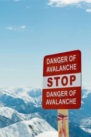 Avalanche sign and mountains at the background photo