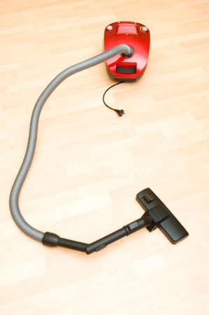 Vacuum cleaner on the wooden floor photo