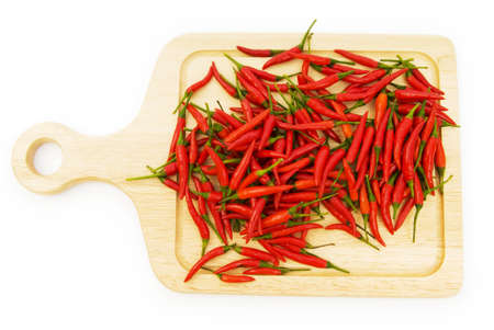 Pepper and cutting board isolated on the white photo