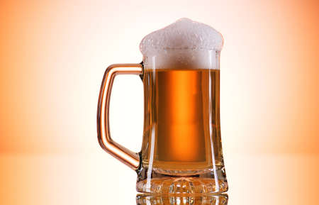 Beer glasses against the colorful gradient background Stock Photo - 7546273