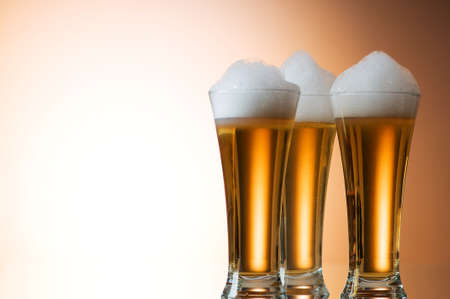 Beer glasses against the colorful gradient background Stock Photo - 7546403