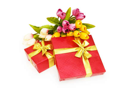 Giftbox and flowers isolated on the white background photo