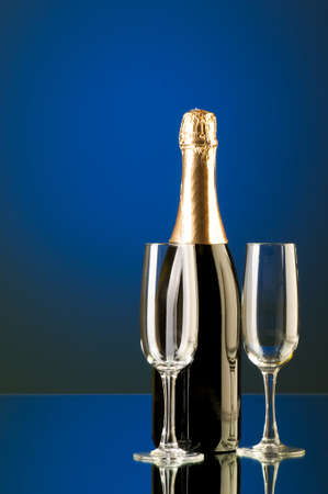 Champagne against color gradient background photo
