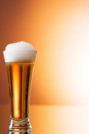 Beer glasses against the colorful gradient background photo
