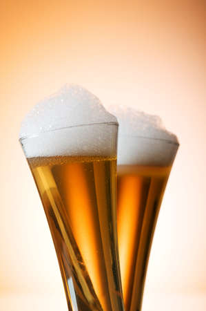 Beer glasses against the colorful gradient background Stock Photo - 7597445
