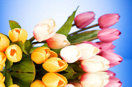Bouquet of colorful tulips on the table photo