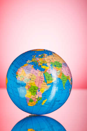 Globalisation concept - globe against gradient colorful background Stock Photo - 7597519