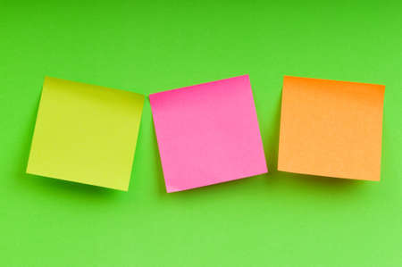 Reminder notes on the bright colorful paper Stock Photo - 7602423