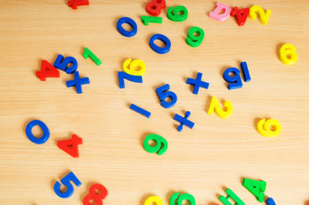 Children letters and digits on the table Stock Photo - 7602396
