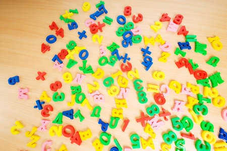 Children letters and digits on the table Stock Photo - 7602397