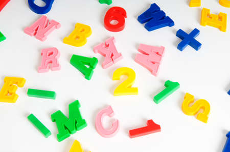Children letters and digits on the table Stock Photo - 7602305