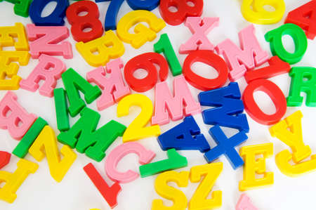 Children letters and digits on the table Stock Photo - 7602351