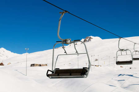winter day: Ski lift chairs on bright winter day