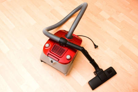 Vacuum cleaner on the wooden floor photo
