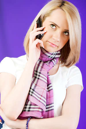 Blond girl talking on mobile phone photo