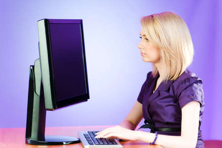 Student working at the computer photo