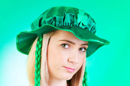 irish woman: Saint Patrick day concept with young girl Stock Photo