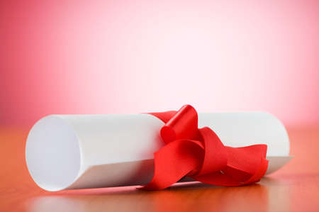 Education concept - diploma roll on the wooden table Stock Photo - 7633739