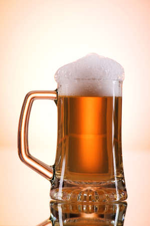 Beer glasses against the colorful gradient background Stock Photo - 7633772