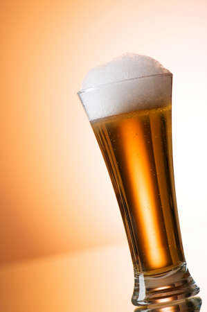 Beer glasses against the colorful gradient background Stock Photo - 7633761