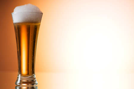 Beer glasses against the colorful gradient background Stock Photo - 7633633