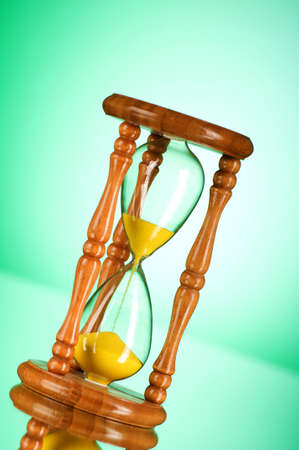 Time concept - hourglass against the gradient background Stock Photo - 7633784