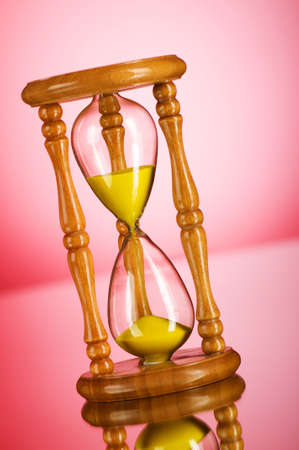 Time concept - hourglass against the gradient background Stock Photo - 7633825