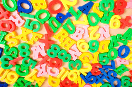 Children letters and digits on the table Stock Photo - 7634233