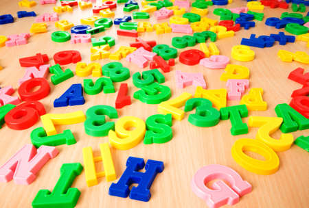 Children letters and digits on the table Stock Photo - 7634824