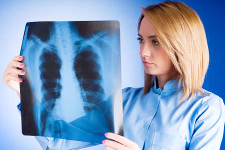 Female doctor carefully x-ray of patient Stock Photo - 7641147