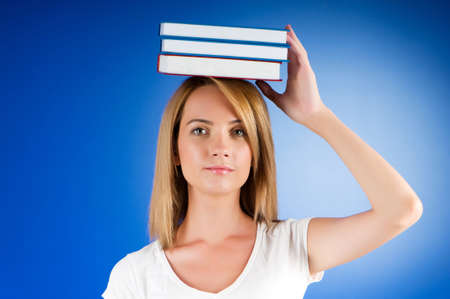 Young university student with many study textbooks Stock Photo - 7641093