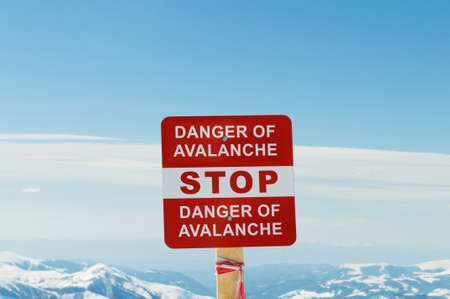 avalanche: Avalanche sign and mountains at the background Stock Photo