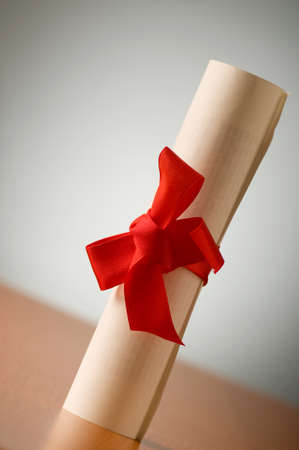 Education concept - diploma roll on the wooden table Stock Photo - 7664568