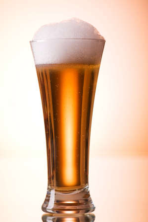 Beer glasses against the colorful gradient background Stock Photo - 7664499