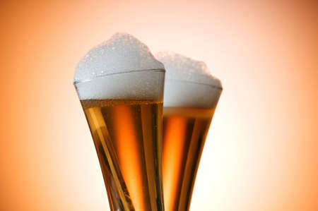 Beer glasses against the colorful gradient background Stock Photo - 7664528
