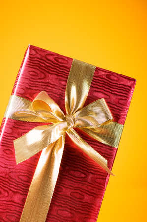 Celebration concept - Gift box against colorful background photo