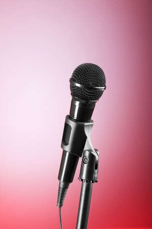 Black microphone against the colorful gradient background Stock Photo - 7664624