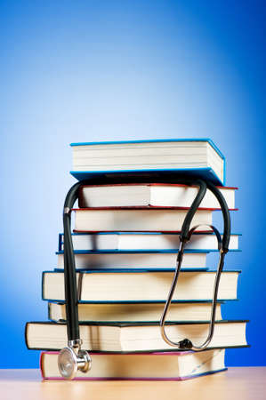 Books and stethoscope against the gradient background Stock Photo - 7664815
