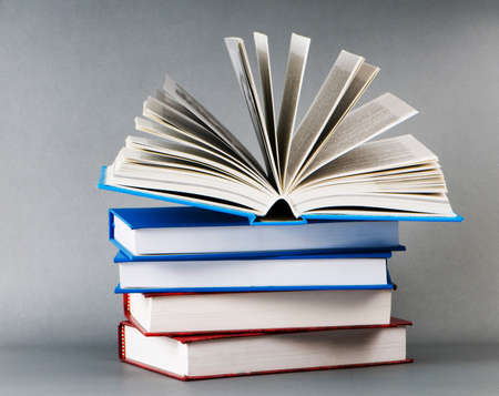 Stack of books on the color background photo