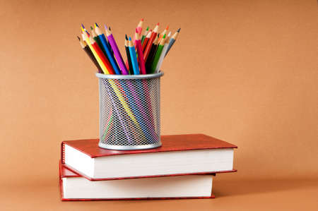 pen holder: Back to school concept with books and pencils Stock Photo