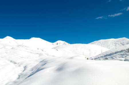 destination scenic: High mountains under snow in the winter Stock Photo