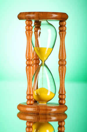 Time concept - hourglass against the gradient background Stock Photo - 7813987