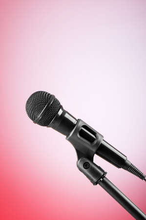 Black microphone against the colorful gradient background Stock Photo - 7813851